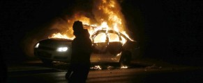A car burns on the street after a grand jury returned no indictment in the shooting of Michael Brown in Ferguson, Missouri