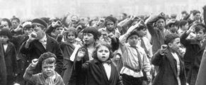 Children March and Sing in May Day Parade